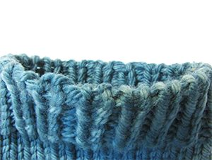 Italian cast-on edge on worsted turquoise yarn