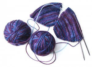Purple malabrigo socks in progress, two at a time