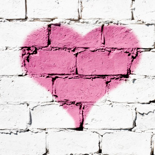 pink heart on white brick